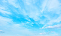 Blue spring sky with light clouds