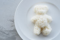 Teddy Bear Shaped Steamed White Rice Served On White Plate