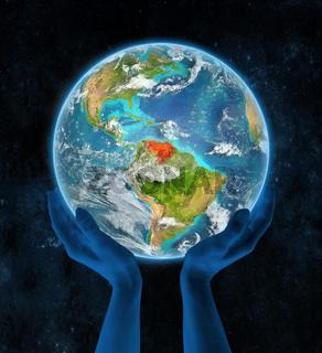 Venezuela on planet Earth in hands