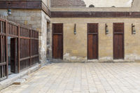 Three adjacent doors in a stone bricks wall and wooden fence, Sultan Al Nassir Qalawun Mosque