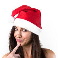 Smiling woman in Santa Claus hat