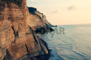 Sedimentary Rock Cliff at the sea, Limestone Natural Structure Coast, Mointain Chain of Layered Stone Formation along the Beach, High Shoreline Eroded Crag