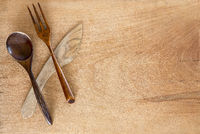 Wooden spoon knife and fork on wooden background