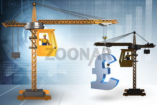 Construction crane lifting british pound in currency business co