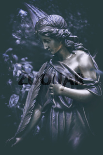 portrait of a bronze tomb angel with feather in magenta ambience