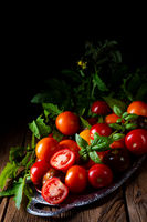 various types of tomatoes served and presented on the silver platter.