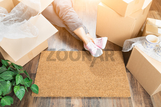 Woman Wearing Sweats Relaxing Near Home Sweet Home Welcome Mat, Moving Boxes and Plant