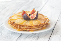 Stack of crepes on the white plate