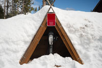Electric Vehicle Charging Station Covered in Snow