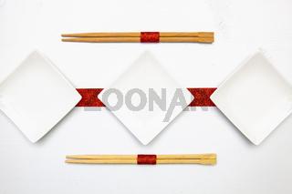 Ceramic bowls  and bamboo chopsticks for sushi food .
