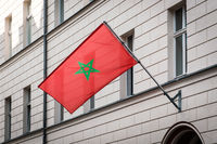 morocco flag - moroccan flag on pole on building