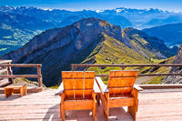 Relax deck chair Swiss Alps panorama,  Pilatus mountain tourist destination