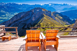 Relax deck chair Swiss Alps panorama,  Pilatus mountain tourist destination