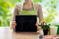 close up of female gardener with tablet pc