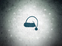 Entertainment, concept: Christmas Hat on Digital Data Paper background