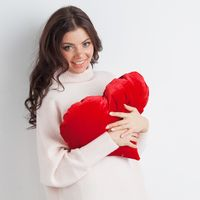 Woman with pillow heart