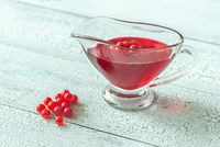 Glass boat of red currant jam
