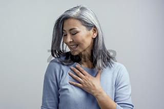 Beautiful Asian woman posing in studio