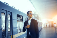 Businessman waiting for train in subway.