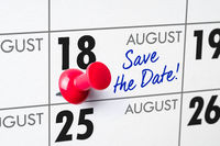 Wall calendar with a red pin - August 18