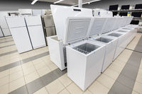 rows of freezers and refrigerators in appliance store