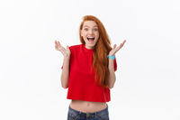 Surprised happy beautiful woman looking in excitement. Isolated on gray background