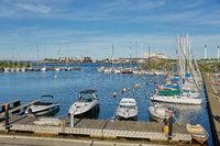 Luxury speedboats docked along side of wooden promenade at Danish capital of Copenhagen