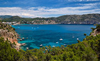 Bay with luxury yachts rocky mountains of Cala Blanca Andratx, Mallorca, Spain