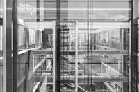 Abstract window reflections in morden office building. Black and white photo.