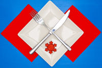 White square plate and red Christmas decoration