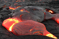 Pouring lava on the slope of the volcano. Volcanic eruption and magma.