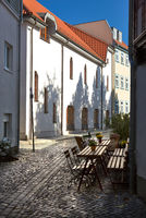 Cozy outdoor cafe on traditional pedestrian street in Erfurt