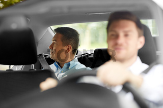 middle aged male passenger and car driver