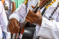 Acoustic guitar player performing during brazilian popular religious festival