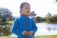 Girl at the backyard with shallow lake