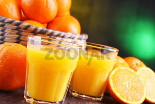 Glasses with freshly squeezed orange juice and fruits
