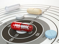 Pills on target and probiotic in the center.  Scientific research or best prescription medication concept.
