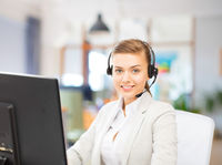 helpline operator in headset working at office