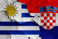 flags of Uruguay and Croatia painted on cracked wall