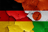 flags of Germany and Niger painted on cracked wall