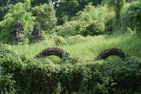 Traditional hindu statue of dragon in the garden in Bali