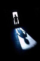 Figure standing in backlight