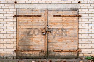 Garage door with padlock and hinges