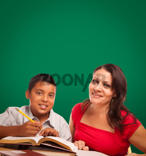 Blank Chalk Board Behind Hispanic Young Boy and Famale Adult Studying