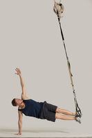 Body TRX training at elastic rope at gym