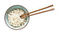 chopsticks in bowl with boiled rice isolated