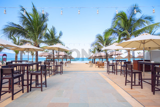 Abstract photo of empty cafe on the beach at tropical sea