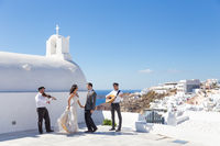 Bride and groom dansing on wedding ceremony on Santorini island, Greece.