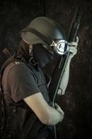 Guard, man armed with shotgun and bulletproof vest