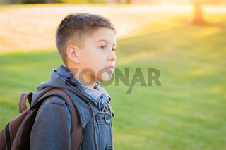 Young Hispanic Boy Walking Outdoors With Backpack